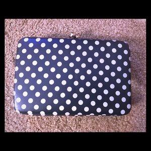 Navy and white polka dot clutch